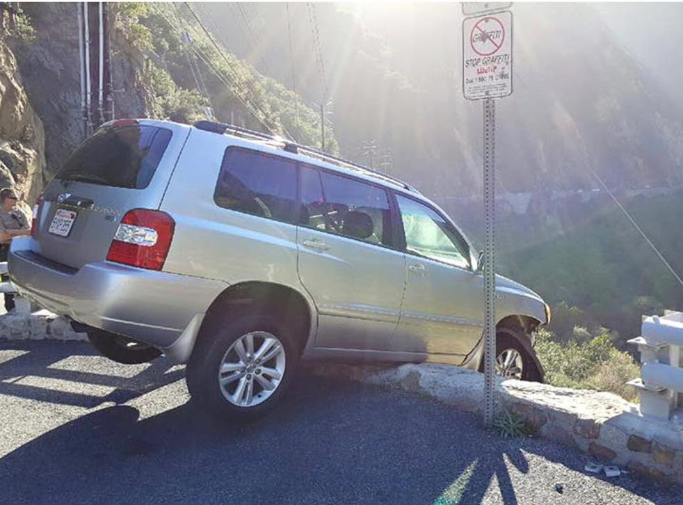 The SUV was found hanging off the edge of the cliff