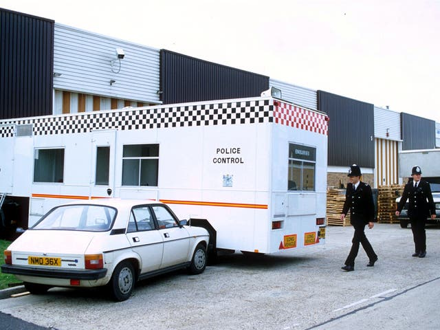Policemen at the scene of the Brink's Mat robbery at Heathrow airport in 1983