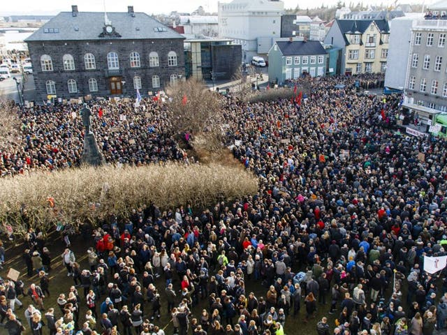 People gather during a protest on Austurvollur Square in front of the Icelandic Parliament in Reykjavic, Iceland, calling for the resignation of prime minister Sigmundur Davíð Gunnlaugsson on 04 April, 2016,