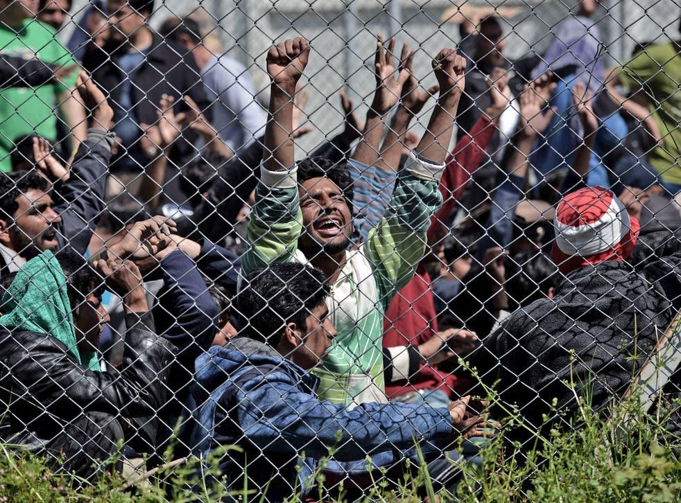Refugees protest inside a detention center in Mytilene, Lesbos