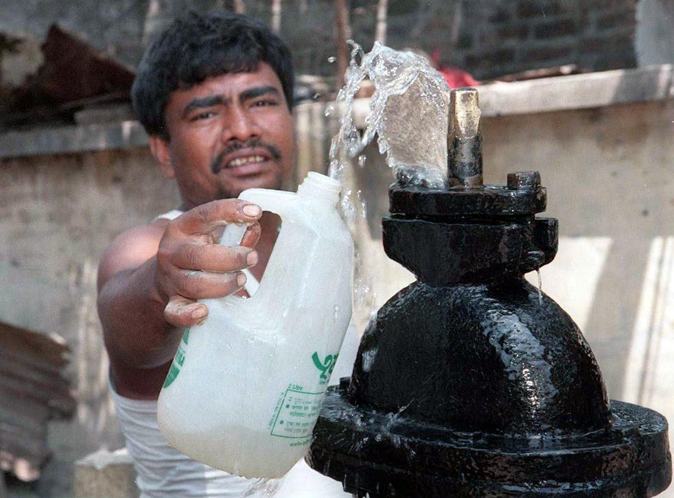 A Bangladeshi man fills a bottle at one of the nation's estimated 20,000,000 groundwater pumps
