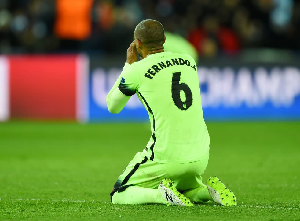 Manchester City midfielder Fernando goes down to his knees after his mistake