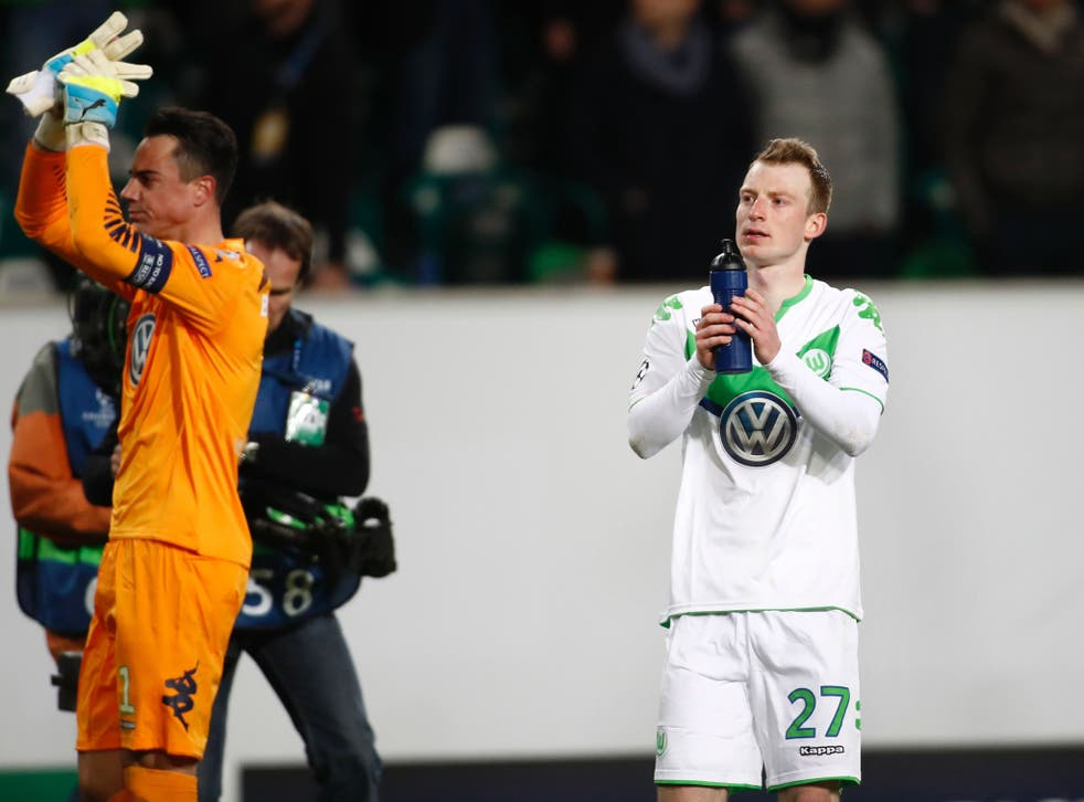 Maximilian Arnold salutes the fans after Wolfsburg's first-leg win