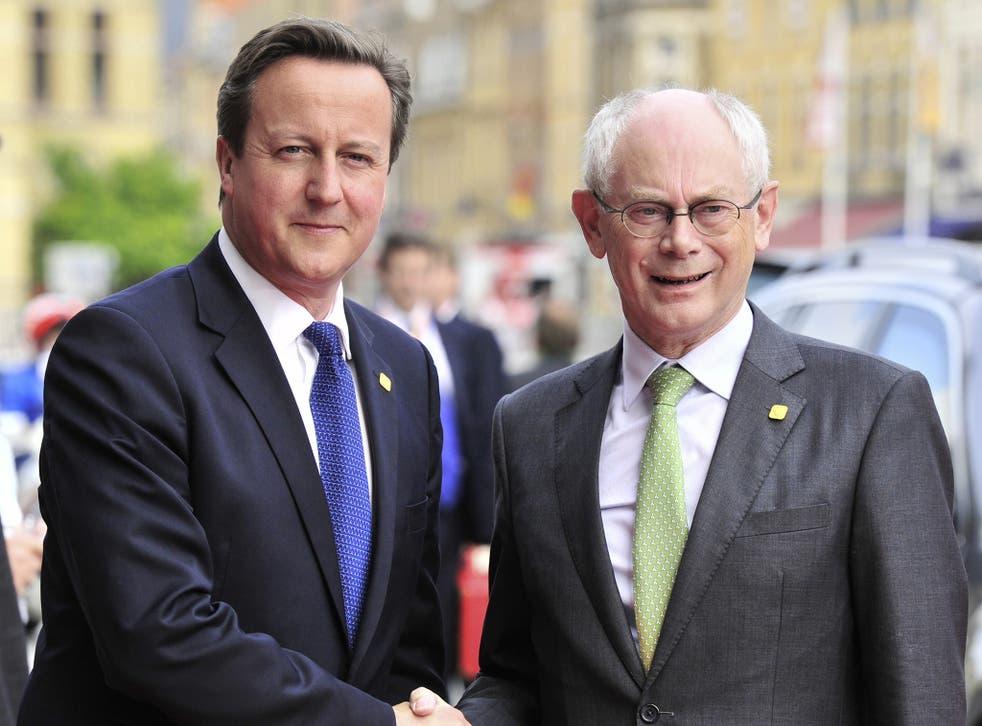 Former European Council President Herman Van Rompuy shakes hands with British Prime Minister David Cameron
