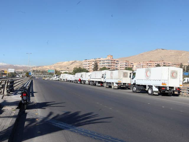 A convoy of trucks laden with with relief head out from Damascus, bound for the rebel-held towns of Madaya and Zabadani, in February. The UN says getting aid into besieged towns has proved difficult