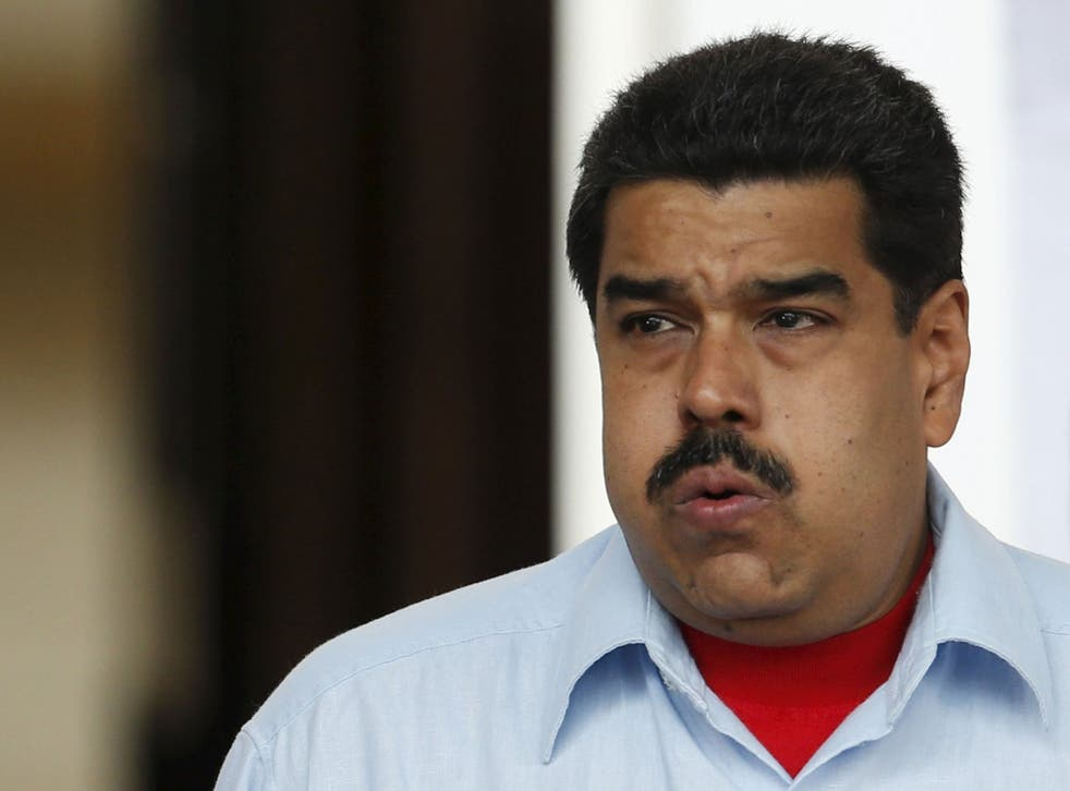 Venezuela's President Nicolas Maduro gestures while he attends a rally in Caracas, April 7, 2016.