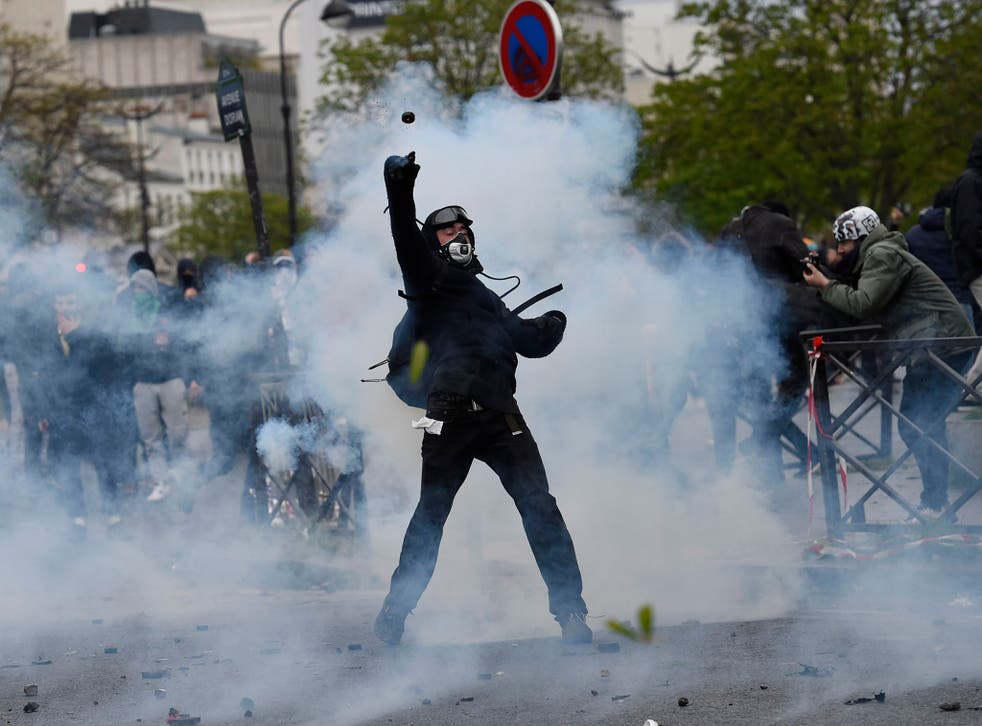 Protesters in Paris threw bottles, sticks and firecrackers at police