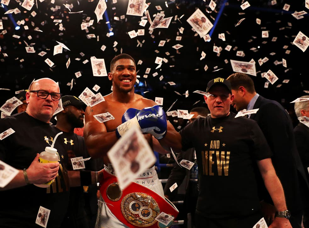 Anthony Joshua celebrates winning the IBF heavyweight championship inside two rounds