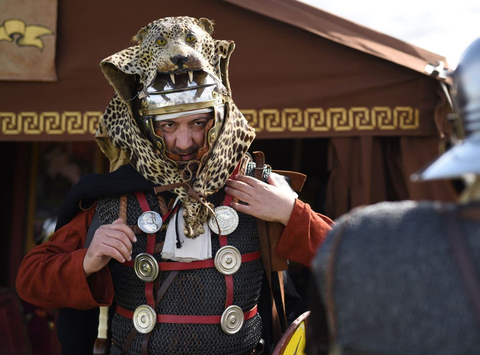 A man prepares for an Imperial Roman Army battle re-enactment at Hadrian's Wall in September 2015