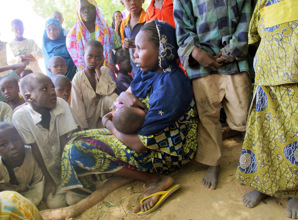 A woman breast-feeding in Cameroon, where up to 50% of girls as young as ten are thought to suffer breast ironing