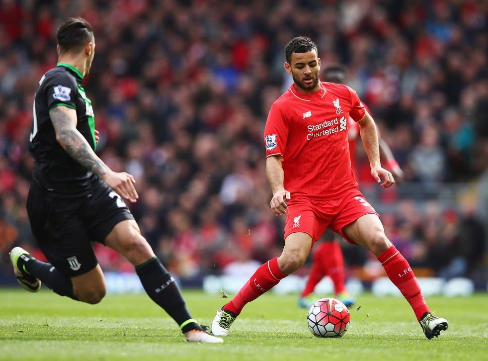 Liverpool midfielder Kevin Stewart plays a pass