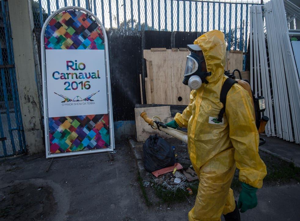 A worker sprays an anti-mosquito agent in Rio de Janeiro to combat the Zika virus