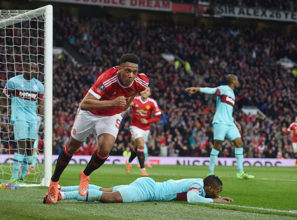Anthony Martial celebrates after scoring against West Ham