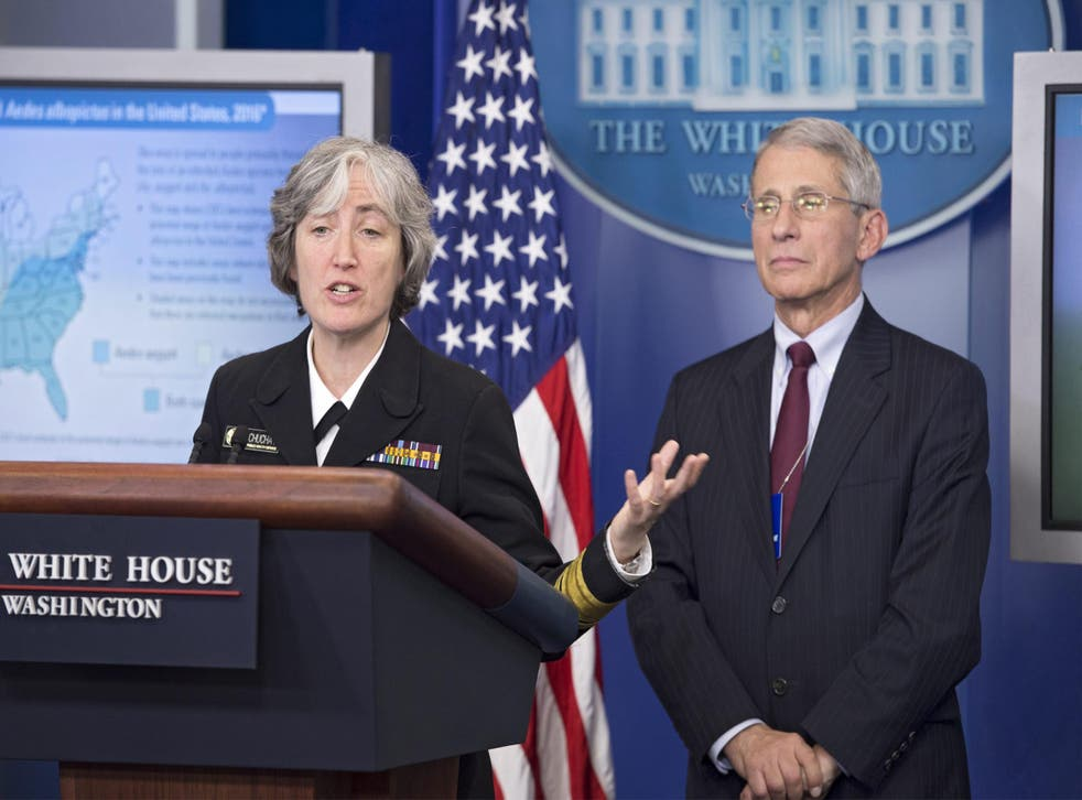 Director of the National Institute of Allergy and Infectious Diseases Anthony Fauci (R) and Dr. Anne Schuchat (L), Principal Deputy Director of the Centers for Disease Control and Prevention (CDC), speaking at the White House