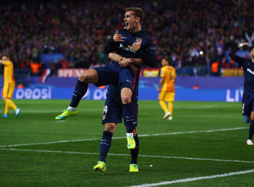 Antoine Griezmann celebrates scoring for Atletico Madrid against Barcelona