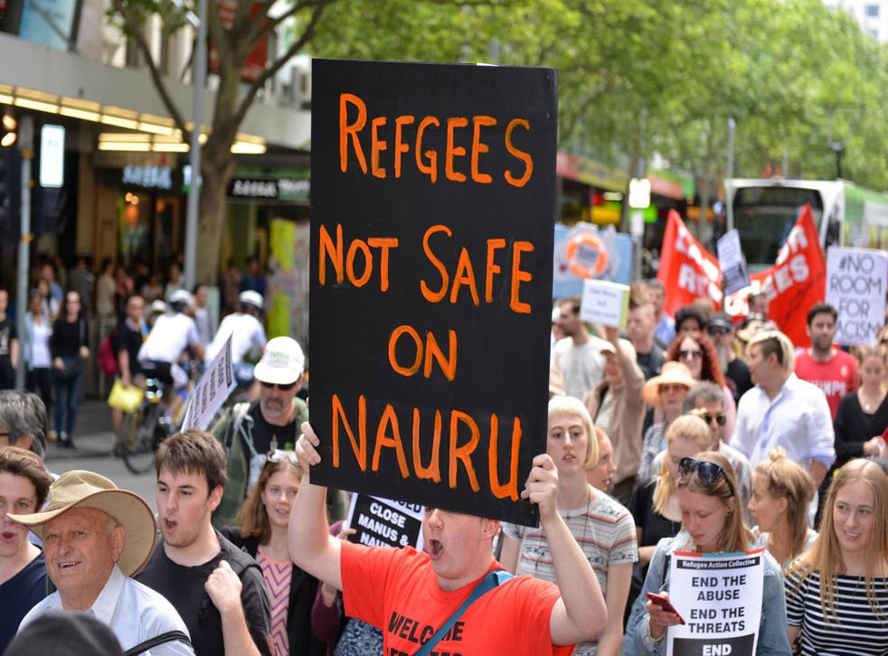Protesters in Melbourne call for the closure of Australian immigration detention centres on the islands of Manus and Nauru