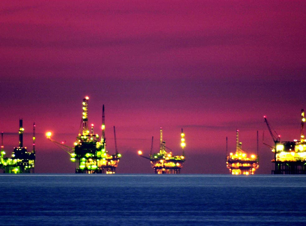 Drilling platforms sit offshore near California. The World Bank expects oil prices to average $41 per barrel this year, down from a projected $51 per barrel in January
