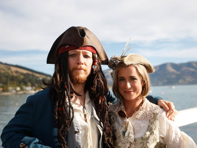 Members of the Church of the Flying Spaghetti Monster dressed as pirates for the wedding, in accordance with religious guidelines