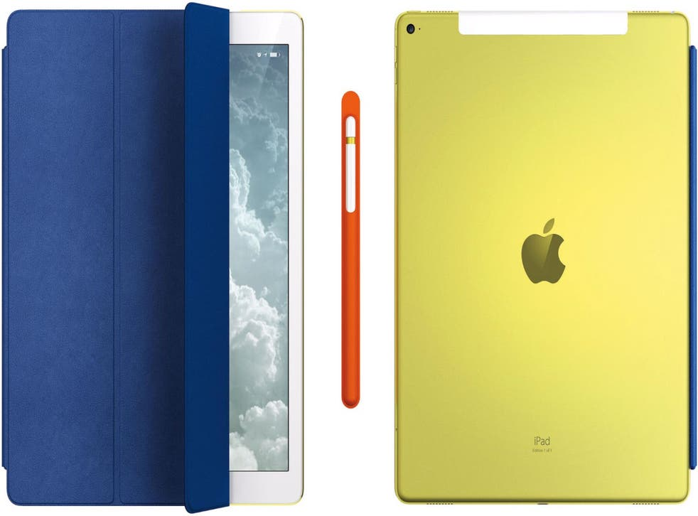 The exclusive lot includes a blue leather Smart Cover (left), an Apple Pencil with orange leather case (centre), and a yellow aluminium iPad Pro