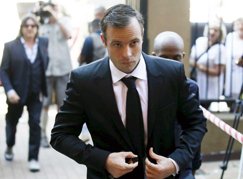 Oscar Pistorius arrives at the North Gauteng High Court in Pretoria
