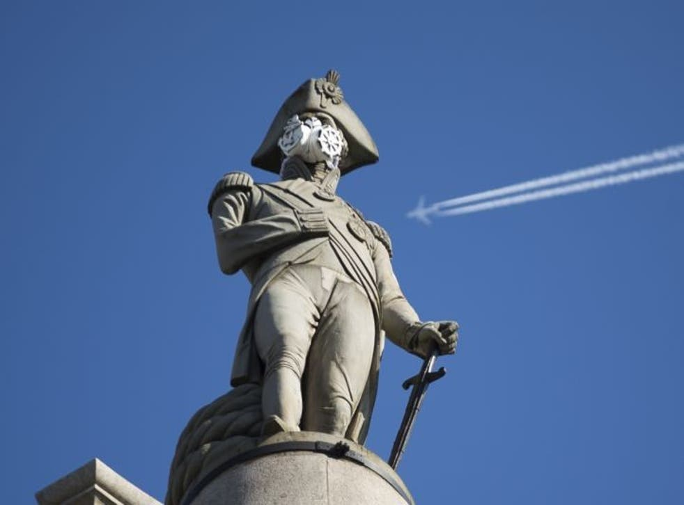 A clean air mask is seen placed on the top of Nelson's Column by Greenpeace activists to protest against air pollution.