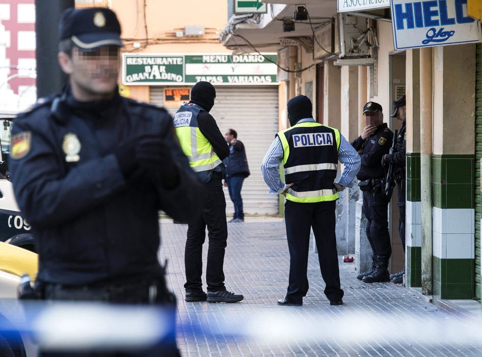 Police secure the flat of a man detained on suspicion of links with Isis in Palma de Mallorca, Spain, on 19 April 2016.
