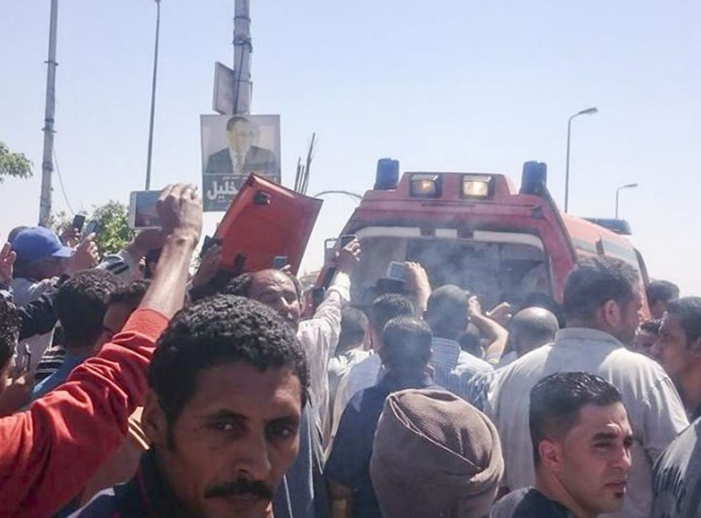 Riots spilled out onto the streets of Cairo after police shot the vendor dead