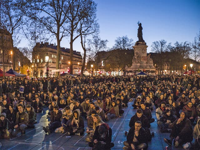People participate in a sit-in protest organised by the Nuit Debout movement in Paris on Tuesday night