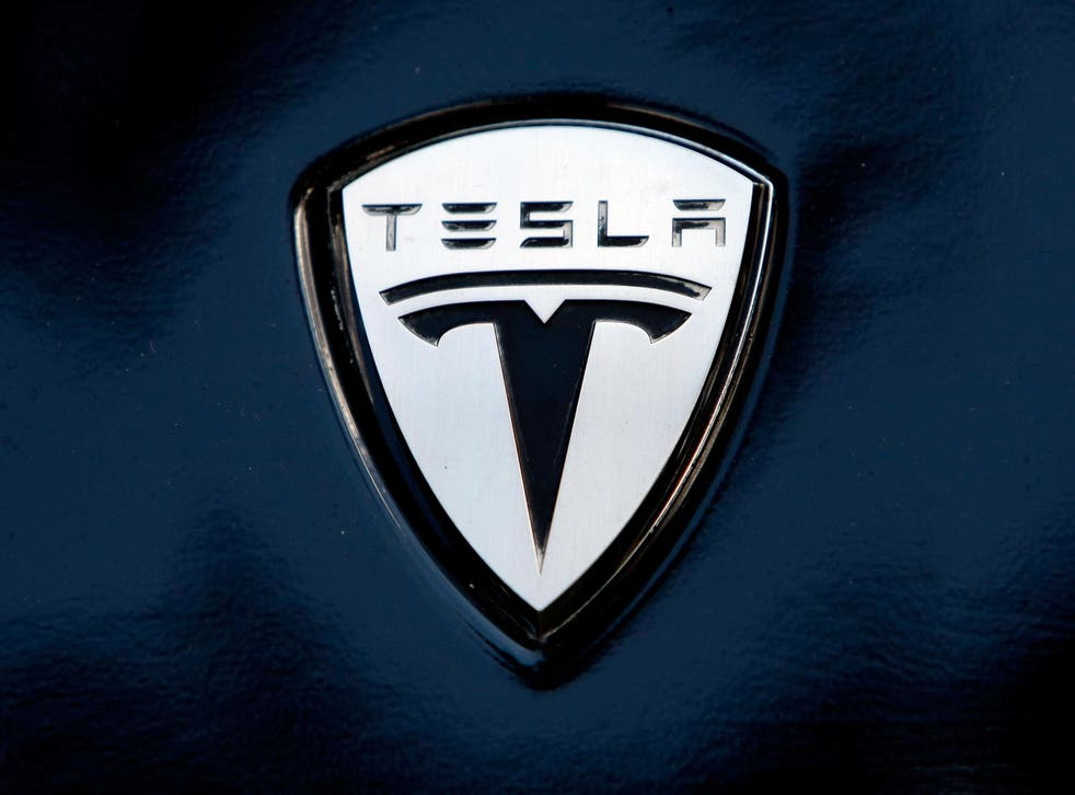 The Tesla logo on the bonnet of one of the company's electric cars