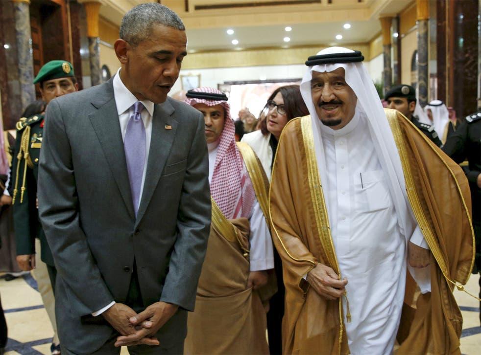 President Obama walks with Saudi King Salman at Erga Palace upon arriving for a summit meeting in Riyadh