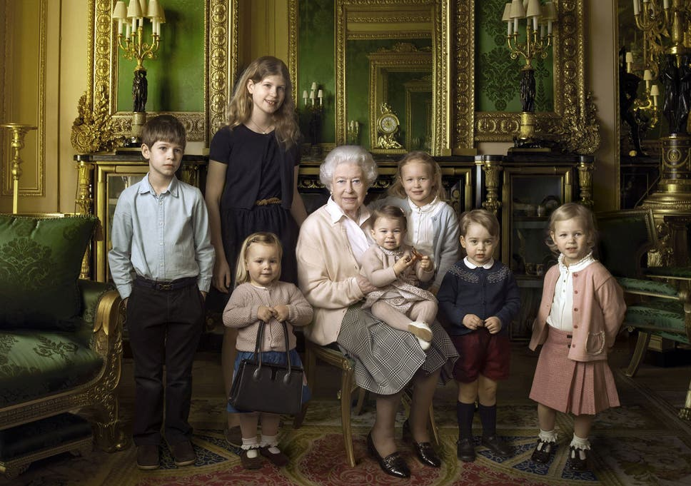 An official photograph, released by Buckingham Palace to mark her 90th birthday, shows Queen Elizabeth II with her five great-grandchildren and her two youngest grandchildren at Windsor Castle