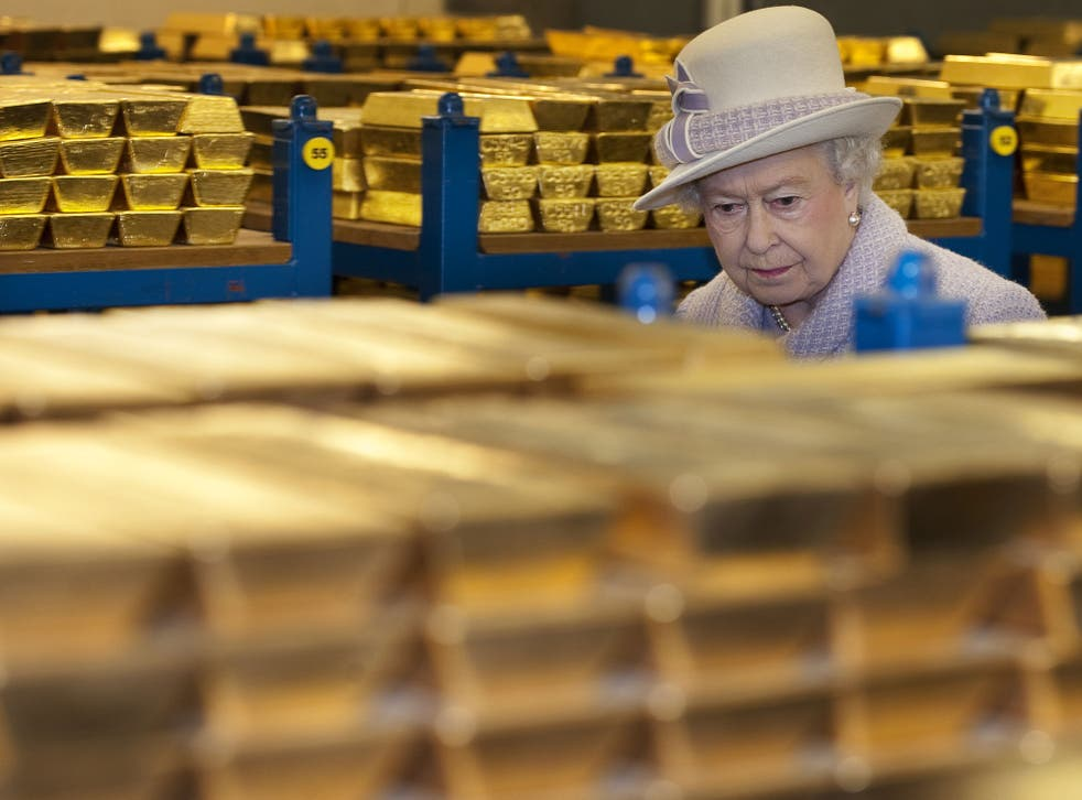 Queen Elizabeth II views stacks of gold as she visits the Bank of England with Prince Philip, Duke of Edinburgh on December 13, 2012 in London, England