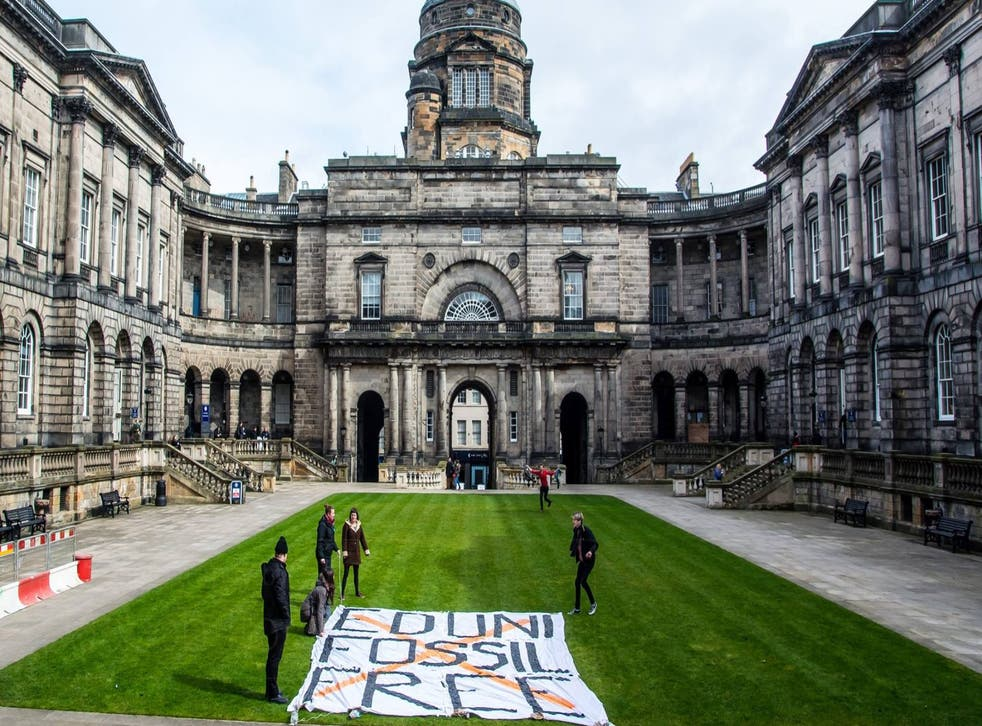 Some of the protesters lay out a banner at the university earlier this month