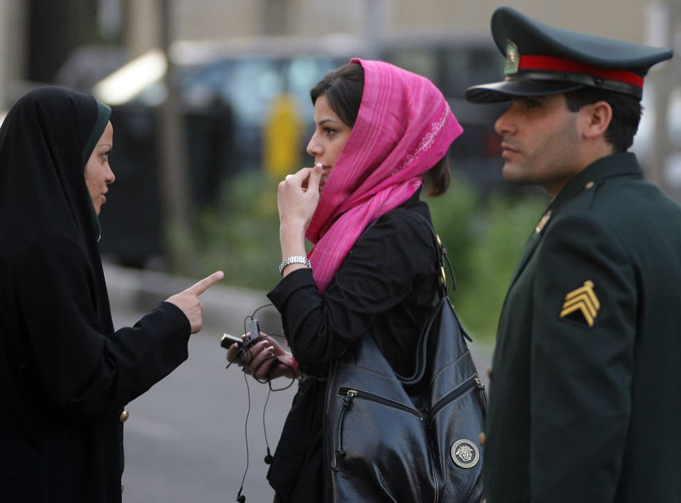 Iranian police enforce the country's strict dress code