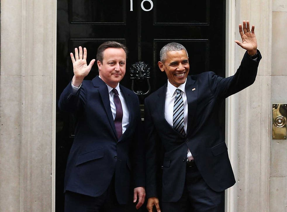 President Barack Obama arrives at Downing Street to meet with British Prime Minister David Cameron