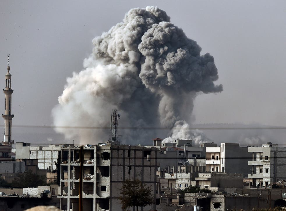 Smoke rises from the the Syrian town of Ain al-Arab, known as Kobane by the Kurds, after a strike from the US-led coalition as it seen from the Turkish-Syrian border in the southeastern village of Mursitpinar, Sanliurfa province, on October 14, 2014.