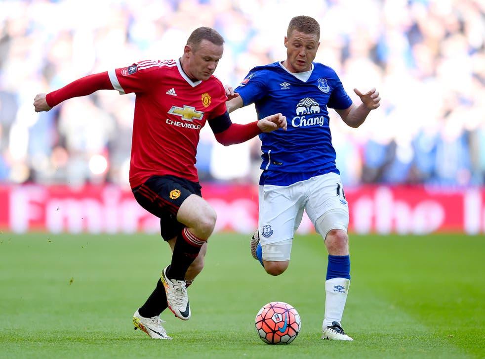 Wayne Rooney battling in midfield with Everton's James McCarthy