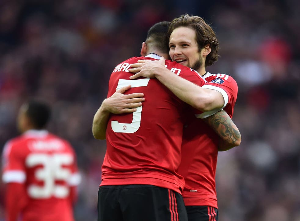 Daley Blind celebrates with Marcos Rojo after Manchester United's victory over Everton