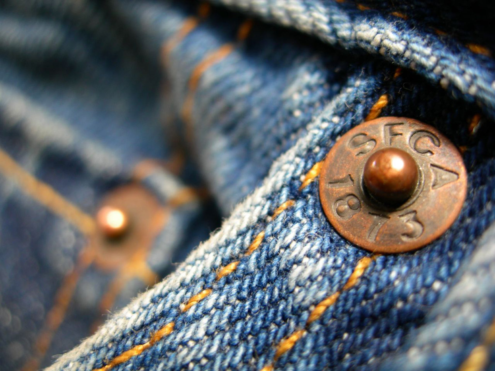 Those tiny bits of metal on the pockets of your jeans are