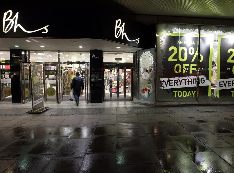 A shopper enters the BHS department store in Oxford Street shortly after 7am on November 28, 2008