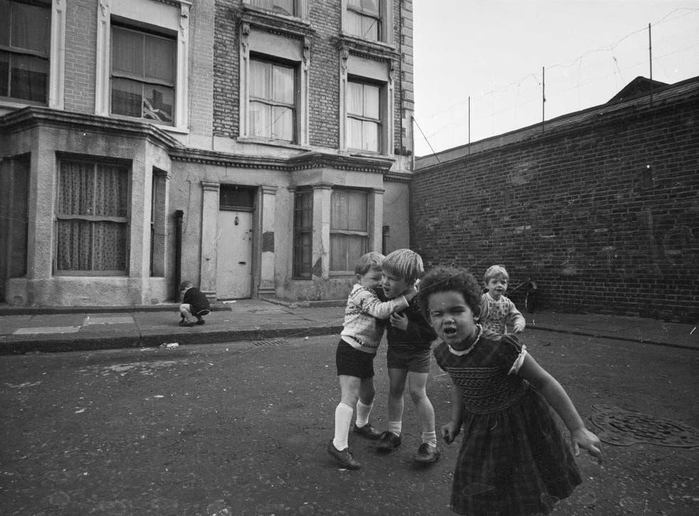 Children play outside 10 Rillington Place, once the home of mass murderer John Christie, in 1966