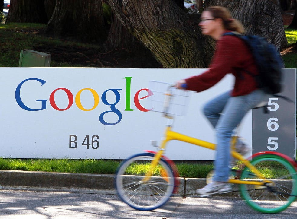 A Google employee rides through the company's headquarters in Mountain View, California in 2010