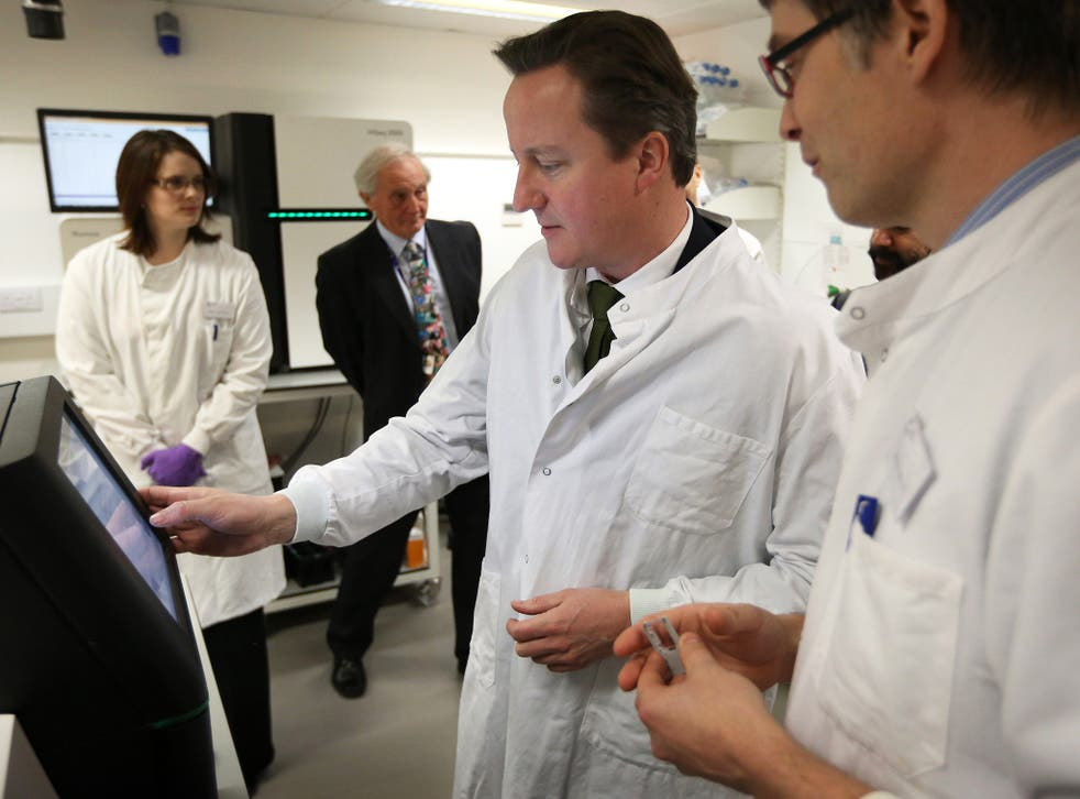 David Cameron visiting the Cancer Research UK Cambridge Institute in 2012