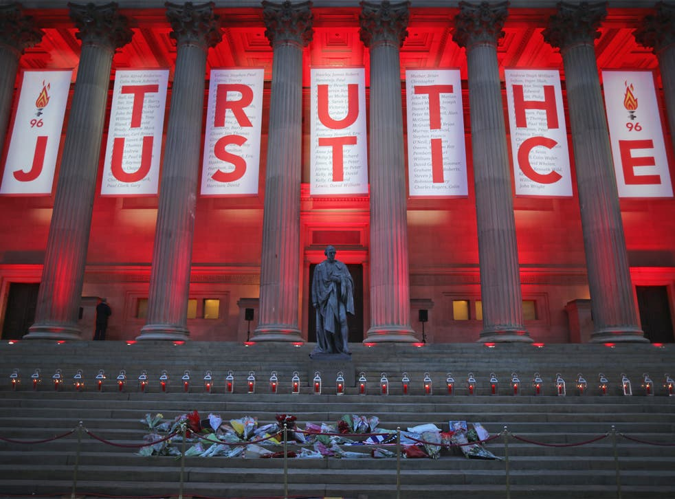 A banner reading 'Truth' and 'Justice' hangs from Liverpool's Saint George's Hall