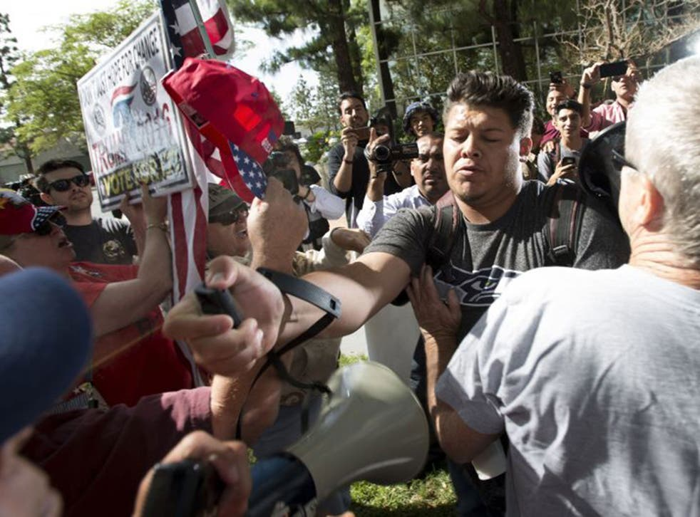 Trump supporters and protesters clash in Anaheim ahead of the Republican front-runner's first campaign appearance in California