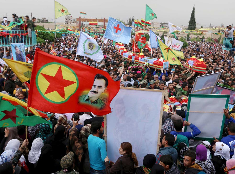 A funeral procession for Kurds killed in clashes with Syrian pro-government forces