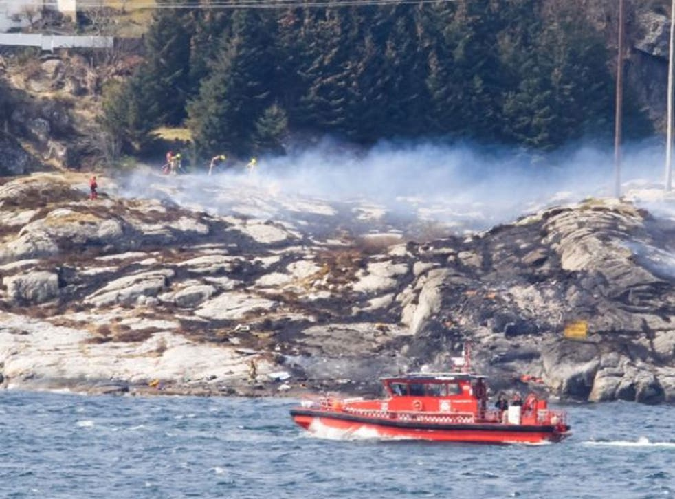 Rescue forces work at the shore west of Bergen, Norway after a helicopter transporting 13 workers from an offshore oil field in the North Sea crashed off on 29 April, 2016