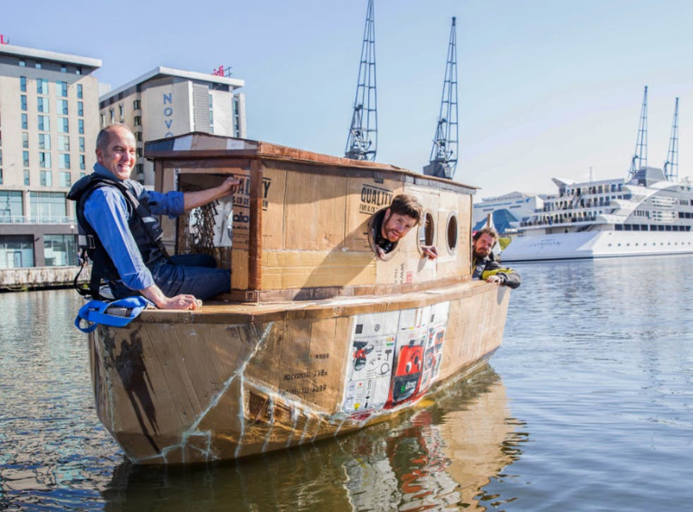 Kevin McCloud sailing in the cardboard houseboat on the River Thames