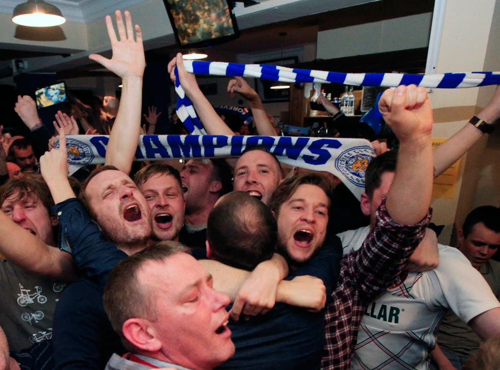Leicester City fans celebrate in the Market Tavern in Leicester