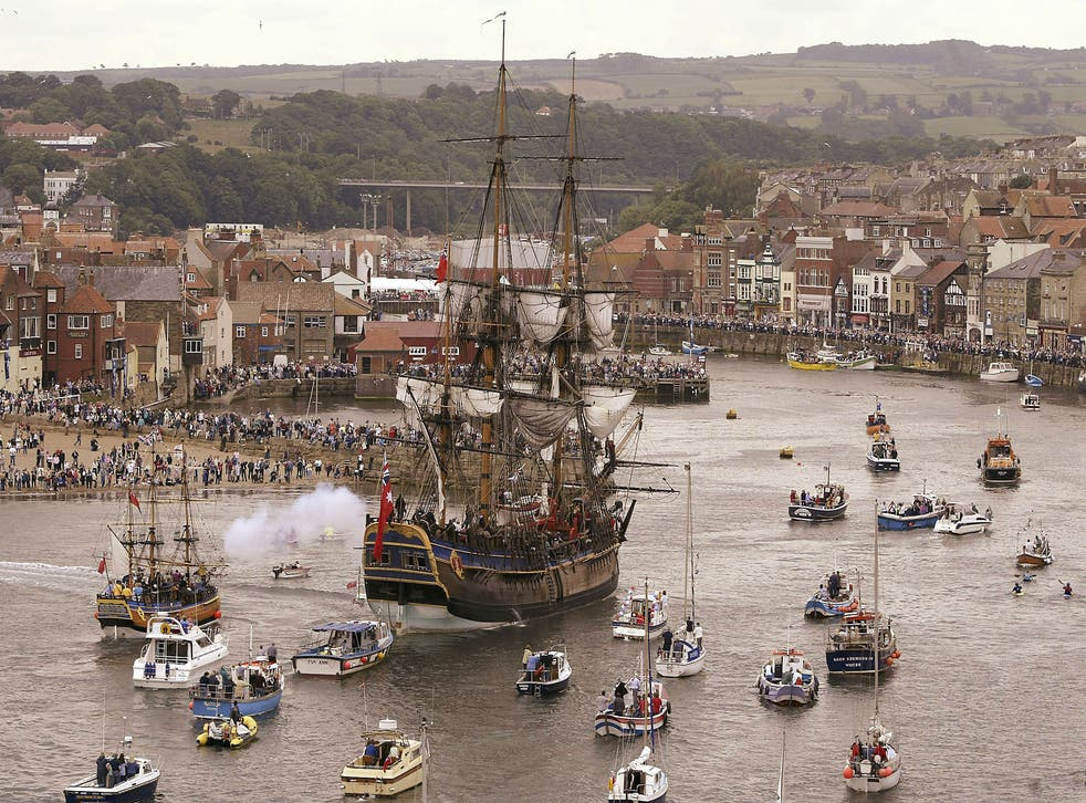 A replica of the Endeavour sailing into Whitby harbour